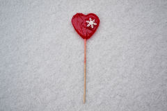 Red Valentine heart lollypop. Valentine red lollypop in snow Royalty Free Stock Images