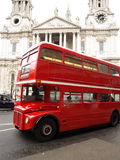Red London Bus. With St Paul's Cathedral in the background Stock Photo