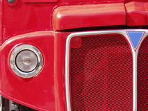 Red London Bus Grille. Close-up of the front of a classic red London double-decker bus royalty free stock photos