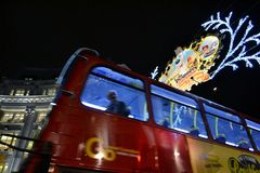 Red London bus is moving in Reagents Street. Royalty Free Stock Photos