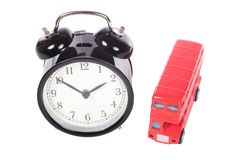 Red London bus with a retro alarm clock Stock Photo