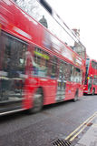Red london buses moving Royalty Free Stock Images