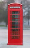 Red London phone booth. A shot of a red London phone booth royalty free stock photo