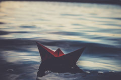 Red lonely paper boat Royalty Free Stock Images