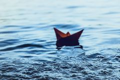 Red lonely paper boat Royalty Free Stock Image