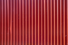 Red long goffered metal texture, corrugated steel Royalty Free Stock Photos