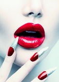 Red Long Nails and Red Glossy Lips Royalty Free Stock Image