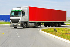Red lorry. Side view of long red semi lorry stock photos
