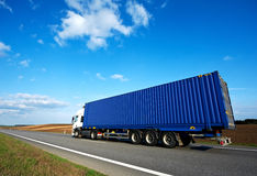 Red lorry with grey trailer over blue sky Royalty Free Stock Photo