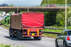 Red lorry truck on uk motorway in fast motion.  royalty free stock photography