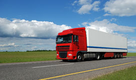 Red lorry with white trailer Royalty Free Stock Photo