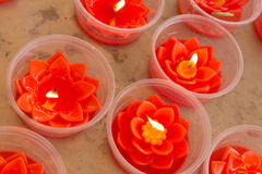 Red lotus shape candles Stock Photos