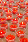 Red lotus shape candles Royalty Free Stock Images