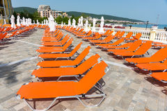 Red loungers near the hotel complex in Sunny Beach in Bulgaria. Bulgaria - a favorite vacation spot of tourists from all over the world royalty free stock photos