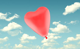 Red love heart balloon on blue sky background Royalty Free Stock Image