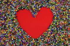 Red love heart in colorful beads Royalty Free Stock Photography