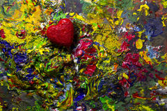 Red love heart on colorful palette. Red love heart on colorful artistic palette stock photography
