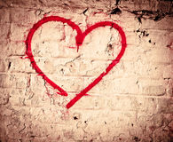 Red Love Heart hand drawn on brick wall grunge textured background Stock Photography