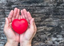 Free Red Love Heart On Woman S Hand Support On Aging Old Wood For Promoting For Health Care Campaign Concept Stock Photography - 200053312