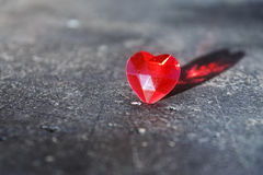 Red  love heart with reflection on a gray stone surface, valenti Stock Photo
