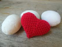 Red love heart and white egg Royalty Free Stock Image
