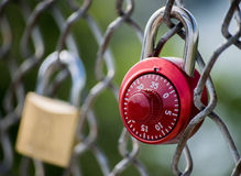 Red love lock on chain link fence Royalty Free Stock Photos