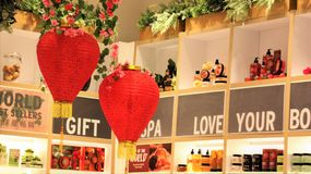 Red love-shape Chinese decoration lanterns handing in a gift shop royalty free stock images