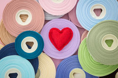Red love valentine heart symbol on ribbon rolls Stock Images