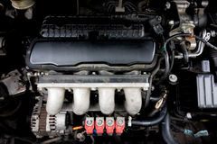 Red LPG injector with engine Royalty Free Stock Photos