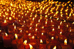 Red lucky candles for prayers Stock Photo