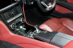 Red luxury car Interior with steering wheel, shift lever and air Stock Images