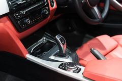 Red luxury car Interior with steering wheel, shift lever and air Stock Photo