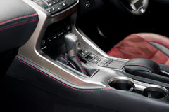 Red luxury car Interior with steering wheel, shift lever and air Royalty Free Stock Photos