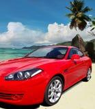 Red luxury car on paradise beach. Stock Photo