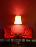 Red luxury chairs with table and lamp Royalty Free Stock Photo