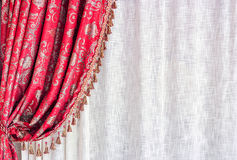 Red luxury curtain. And white tull stock images