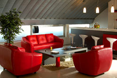 Red luxury office room. Red sofas in luxey office with bar Royalty Free Stock Photography