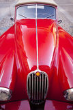 Red luxury retro sports car. Details of the metallic red luxury retro sports car Stock Photo