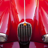 Red luxury retro sports car. Details of the metallic red luxury retro sports car Stock Image