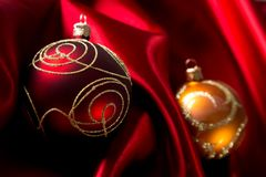 Red luxury satin. With christmas balls royalty free stock photo