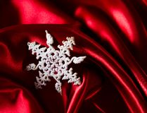 Red luxury satin. With christmas star royalty free stock images