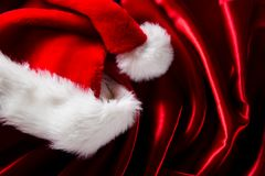 Red luxury satin. With santa cap stock photography