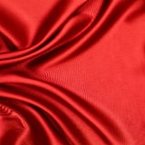 Red luxury satin or silk fabric as background Royalty Free Stock Photography