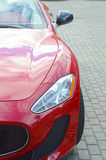 Red luxury sports car Desire. Red expensive sports car Luxury Shine Desire Royalty Free Stock Image