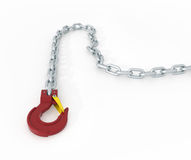 Red lying metal crane hook with steel chain Stock Photo