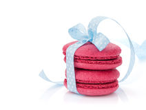Red macarons with blue ribbon Royalty Free Stock Photos