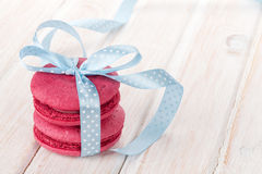 Red macarons with blue ribbon Royalty Free Stock Image