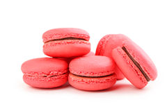 Red macarons. Tasty red macarons isolated on white Royalty Free Stock Image
