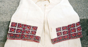 Red  macedonian embroidery on woman shirt Stock Photos