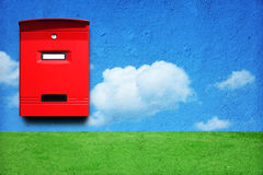 Red mail box. Photo of red mail box on the wall with landscape royalty free illustration